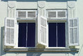 Window with shutters closeup view, sunny day on sea resort Royalty Free Stock Photo