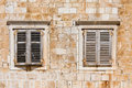Window shutters on old house Stock Photo
