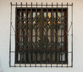 Window in spain with ornate bars and grill Stock Images