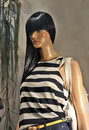 Window store mannequins with female fashion model summer collection Royalty Free Stock Photos