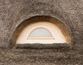 Window on a straw roof Stock Image
