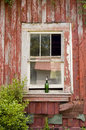 Window surrounded by red peeling paint Royalty Free Stock Photo