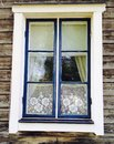 A window to the past an blue in an old house in sweden with lace curtains Royalty Free Stock Images