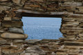Window to the sea from blue stone wall blurred ruined house Royalty Free Stock Photography