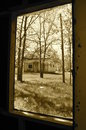 Window view across the yard (sepia) Royalty Free Stock Photo