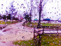 Window view in autumn season with water drops background on the glass blue Stock Images