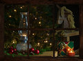 Window view christmas of a living room decorated for as seen through the farmhouse at night Stock Image