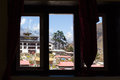 Window view Tengboche village monastery. Nepal. Royalty Free Stock Photo