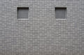 Window void on grey color tile wall in japan Royalty Free Stock Photos