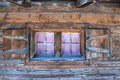 Window of a wodden hut in austria with red checked curtains on wooden Royalty Free Stock Photography