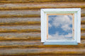 Window in a wooden house old traditional country style with the blue sky and white clouds the Royalty Free Stock Photography