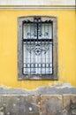 Window on yellow wall Stock Images