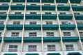 Windows and balconies repetition of in an apartment block Stock Images