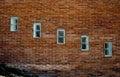 Windows in a brick wall Stock Photo