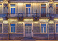 Windows, door and balcony on night facade of apartment building Royalty Free Stock Photo