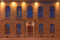 Windows and door on night facade of apartment building Royalty Free Stock Photo
