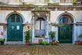 Windows and doors in an old house decorated with flower venice italy june pots flowers Stock Image