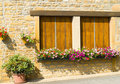 Windows with flower boxes in France Stock Image