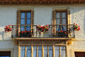 Windows with flowers two european window on a sunny summer day Royalty Free Stock Images