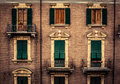 Windows in italy and balconies an old brick building la spezia Royalty Free Stock Photo
