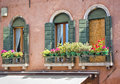 Windows in a mediterranean alley Royalty Free Stock Photo