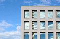 Windows in a modern office block reflect the sky Royalty Free Stock Photo
