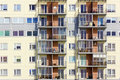 Windows of a multiroom apartment house and balconies mass building Stock Photos