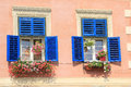 Windows with old blue wood shutters Royalty Free Stock Photo