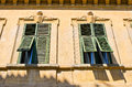 Windows with old open shutters Royalty Free Stock Photo