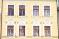 Windows with ornaments renaissance window in yellow house Royalty Free Stock Photos