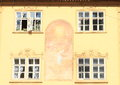 Windows with painting on wall graffito in prague czech republic Royalty Free Stock Images