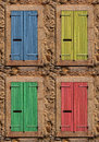 Windows pastel coloured old shutters Stock Photography