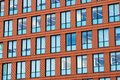 Windows of red office building Royalty Free Stock Photo
