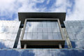 Windows and reflections, modern office building. Royalty Free Stock Photo
