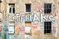 Windows on a ruined building with graffiti street art in berlin exterior Stock Photos