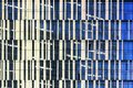 Windows of skyscraper, architecture close up. Glass and concrete. Urban Business District. Modern abstract background Royalty Free Stock Photo
