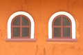 Windows two on rough orange wall Stock Photo