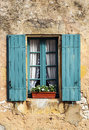 Windows on wall stone with pots it s a vertical picture Stock Photo