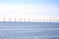 Windpower wind turbines standing in the middle of the baltic sea denmark Royalty Free Stock Photo