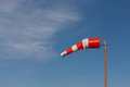 Windsock with blue sky and cirrus clouds Stock Image