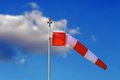 Windsock over blue sky red and white at the airport Royalty Free Stock Images