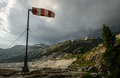 Windsock during strong wind in alps Stock Photography