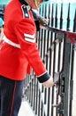 Windsor castle guard locking up the gates Stock Images