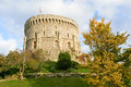 Windsor castle tower and trees at with clouds in background Royalty Free Stock Photo