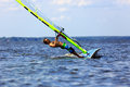 Windsurfer falls side view of a to water Stock Photos