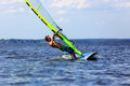 Windsurfer falls side view of young starting a falli Royalty Free Stock Photos