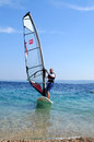Windsurfer men doing windsurfing on mediterranean sea Royalty Free Stock Photography