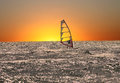 Windsurfer at sunset Stock Images
