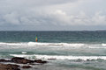Windsurfers in the waves at Umhlanga Rocks Royalty Free Stock Photo