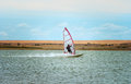Windsurfing sport sailing water active leisure windsurfer on lake summer day Stock Image